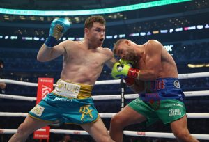 Canelo Alvarez stops Billy Joe Saunders in front of record 73,126 fans in Texas