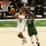Jul 11, 2021; Milwaukee, Wisconsin, USA; Phoenix Suns guard Chris Paul (3) drives for a layup against Milwaukee Bucks guard Jrue Holiday (21) during the third quarter during game three of the 2021 NBA Finals at Fiserv Forum. Mandatory Credit: Jeff Hanisch-USA TODAY Sports