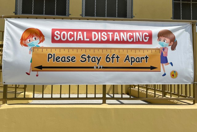 A social distancing sign hangs at Morris K. Hamasaki Elementary School in Los Angeles on July 1. New Covid-19 cases among children are back on the rise after months of declines