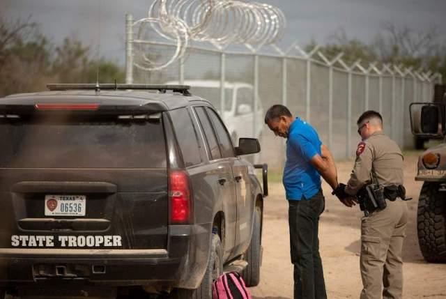 trooper arrests migrant 4