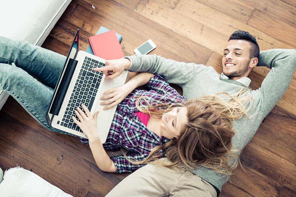 Engaged couple setting up their online wedding RSVP
