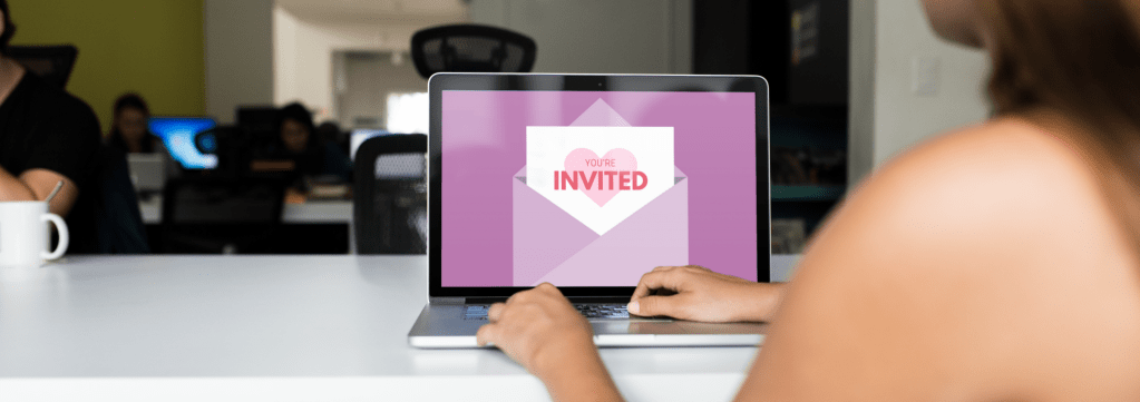 Woman on Computer opens digital invitation
