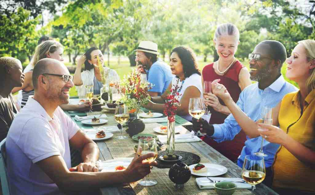Former classmates enjoy meal at class reunion picnic