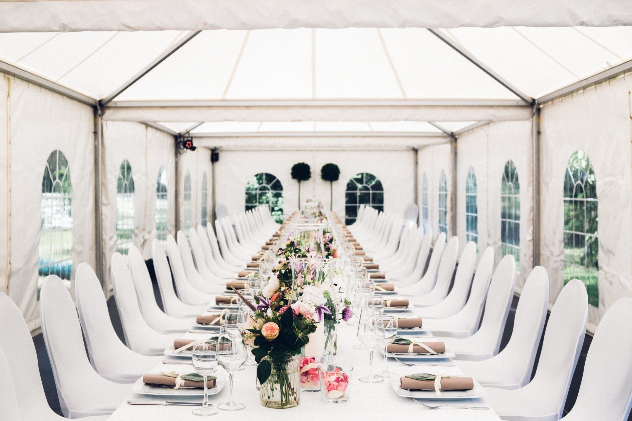 event seating layout with white tables and chairs
