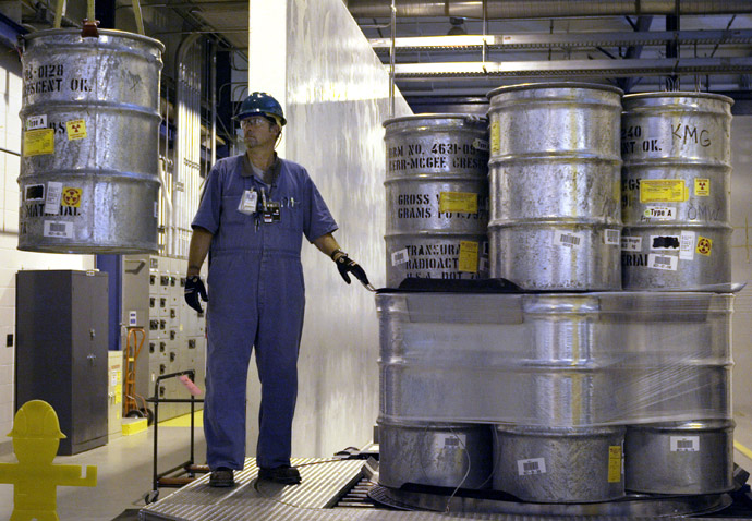 55-gallon drums containing transuranic (TRU) waste are prepared for shipment at the Waste Receiving and Processing facility (WARP) on the Hanford Nuclear Reservation, 30 June, 2005 near Richland, Washington. (Jeff T. Green/Getty Images/AFP)