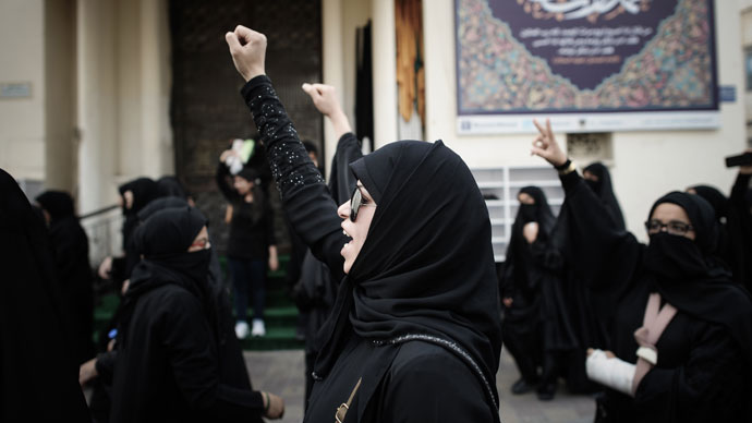 Bahraini women shout slogans as they march during an anti-regime rally in solidarity with jailed human rights activist Nabeel Rajab and against the upcoming Bahrain Formula One Grand Prix in Manama on March 29, 2013.(AFP Photo / Mohammed AL-Shaikh)