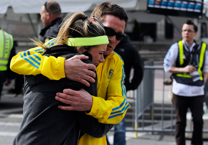 A woman is comforted by a man near a triage tent set up for the Boston Marathon after explosions went off at the 117th Boston Marathon in Boston, Massachusetts April 15, 2013 (Reuters / Jessica Rinaldi)