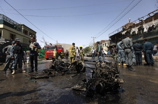 Afghan policemen stand guard at the site of a suicide attack in Kabul May 16, 2013. (Reuters)