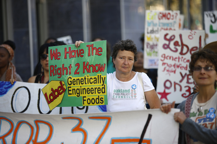 A demonstrator holds a sign during a rally in support of the state's upcoming Proposition 37 ballot measure in San Francisco, California October 6, 2012. (Reuters / Stephen Lam)