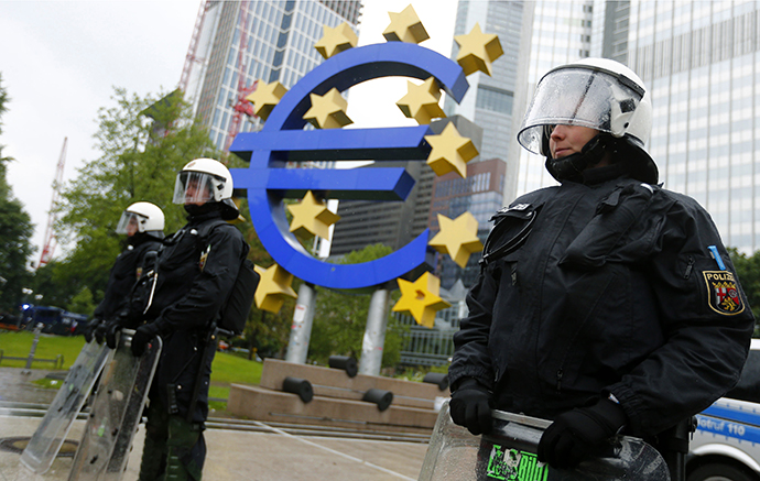 "Riot police stand near the euro sign in front of the European Central Bank (ECB) headquarters during an anti-capitalist ""Blockupy"" demonstration in Frankfurt May 31, 2013. (Reuters / Kai Pfaffenbach)"