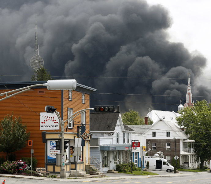 A cloud of smoke is seen over Lac Megantic after a train explosion, July 6, 2013. (Reuters/Mathieu Belanger)