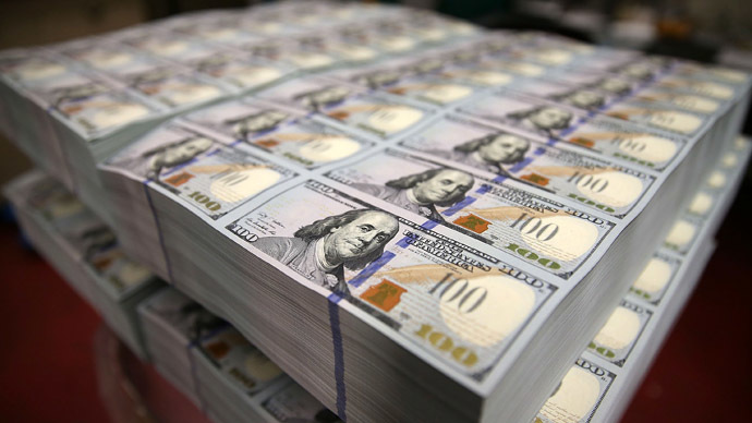 Newly redesigned $100 notes lay in stacks at the Bureau of Engraving and Printing on May 20, 2013 in Washington, DC. (Mark Wilson/Getty Images/AFP)