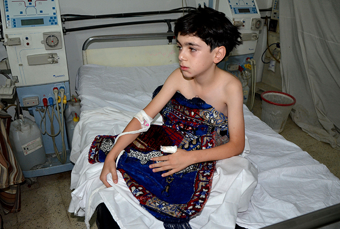 A boy, affected by what activists say is nerve gas, is treated at a hospital in the Duma neighbourhood of Damascus August 21, 2013. (Reuters)
