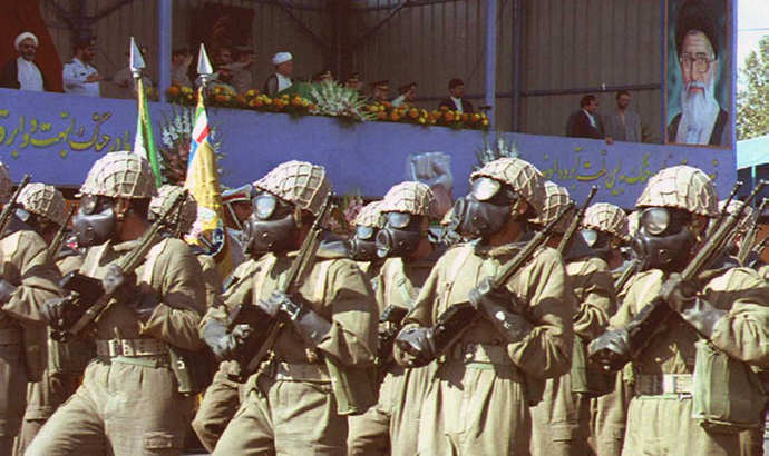 Iranian troops with equipment against chemical weapon attacks parade in front of the official stand at Tehran, 21 September, during ceremonies commemorating the war between Iran and Iraq which started with the Iraqi invasion in 1980 and ended eight years later in a stalemate. (AFP Photo)