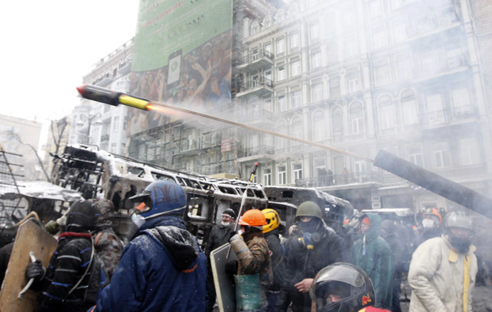 Pro-European protesters launch a pyrotechnic pistol towards riot police during clashes in Kiev January 22, 2014. (Reuters/Vasily Fedosenko)