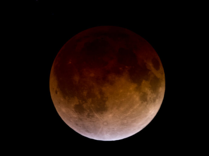 The moon is seen during a total lunar eclipse on April 15, 2014, in Atizapan municipality, Mexico State. (AFP Photo / Ronaldo Schemidt)