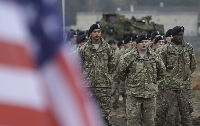 U.S, soldiers deployed in Latvia with the 1st Cavalry Division 1st Brigade Combat team, attend a rotation ceremony at Adazi military base October 14, 2014. (Reuters/Ints Kalnins)