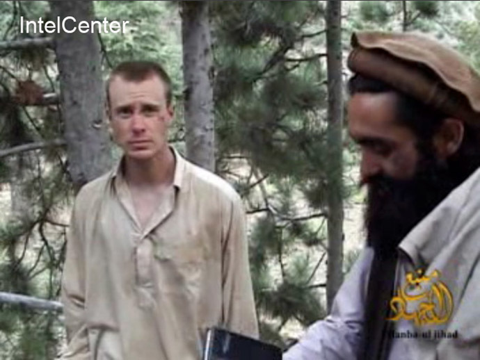 This still image provided on December 7, 2010 by IntelCenter shows the Taliban associated video production group Manba al-Jihad December 7, 2010 release of someone that appears to be US soldier Bowe Bergdahl (L), who has been held hostage by the Taliban since his disappearance from his unit on June 30, 2009. (AFP/IntelCenter)