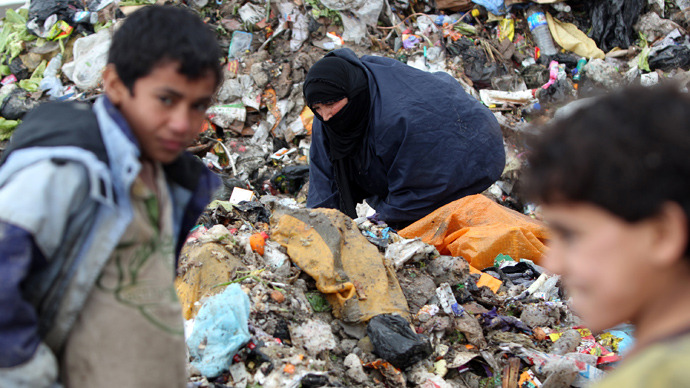 An Iraqi woman searches for plastic bottles in a garbage dump on the outskirts of Baghdad's impoverished district of Sadr City, January 30, 2013 (AFP Photo/ Ahmad Al-Rubaye)