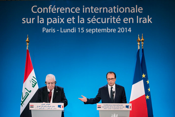 Iraqi President Faud Masum (L) listens while French President Francois Hollande speaks during the International Conference on Peace and Security in Iraq at the Quai d'Orsay on September 15, 2014 in Paris, France. (AFP Photo / Brendan Smialowski)
