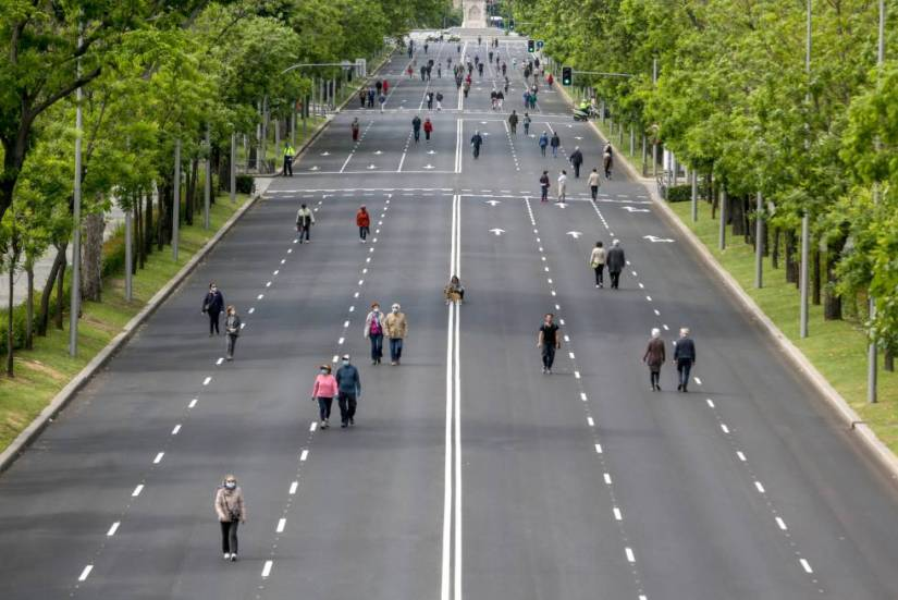Pedestrians stroll along the Paseo de la Castellana in Madrid, which was closed to traffic in May.