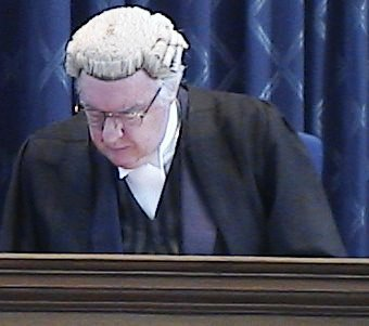 [Picture of Judge in courtroom]