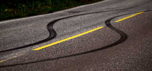 [Picture of tyre tread marks on road, swerving]
