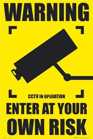 [Picture of cctv warning sign]