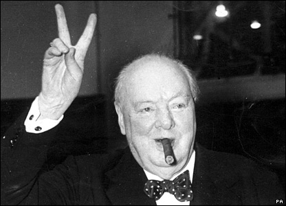 [Picture of UK PM Winston Churchill with cigar and v for victory sign]