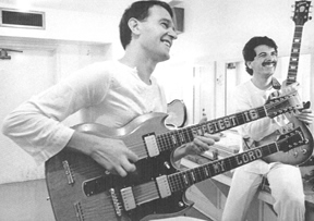 [Picture of John McLaughlin and his double neck]