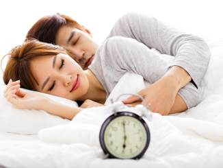 asian couple sleeping
