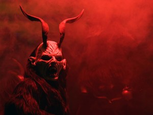 A man dressed as a devil performs during a Krampus show in the southern Bohemian town of Kaplice December 13, 2014. Each year people in traditional costumes and masks parade through the streets to perform an old ritual to disperse the ghosts of winter. REUTERS/David W Cerny (CZECH REPUBLIC - Tags: SOCIETY RELIGION) - RTR4HWIL