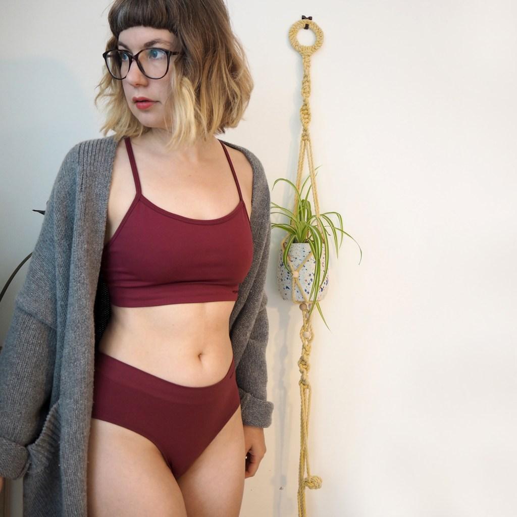 girl wearing organic basics underwear and cardigan