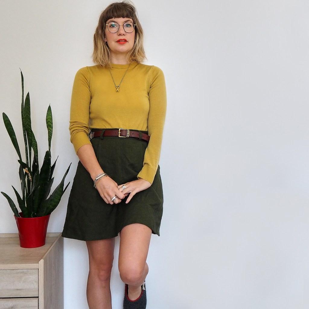 ruby rose wearing a hemp skirt and yellow jumper