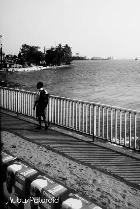 Boy, bridge and open sea monochrome by rubys polaroid