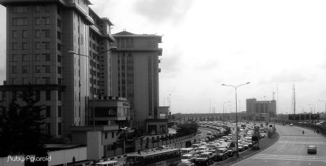 Morning Traffic beside Oriental Hotel Lagos by rubys polaroid