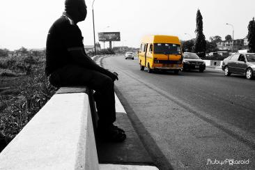 Reflection along the Oworonshoki Expressway Lagos by rubys polaroid