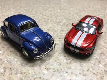 A VW Beetle and a Mustang. Ryan's two favorite cars.