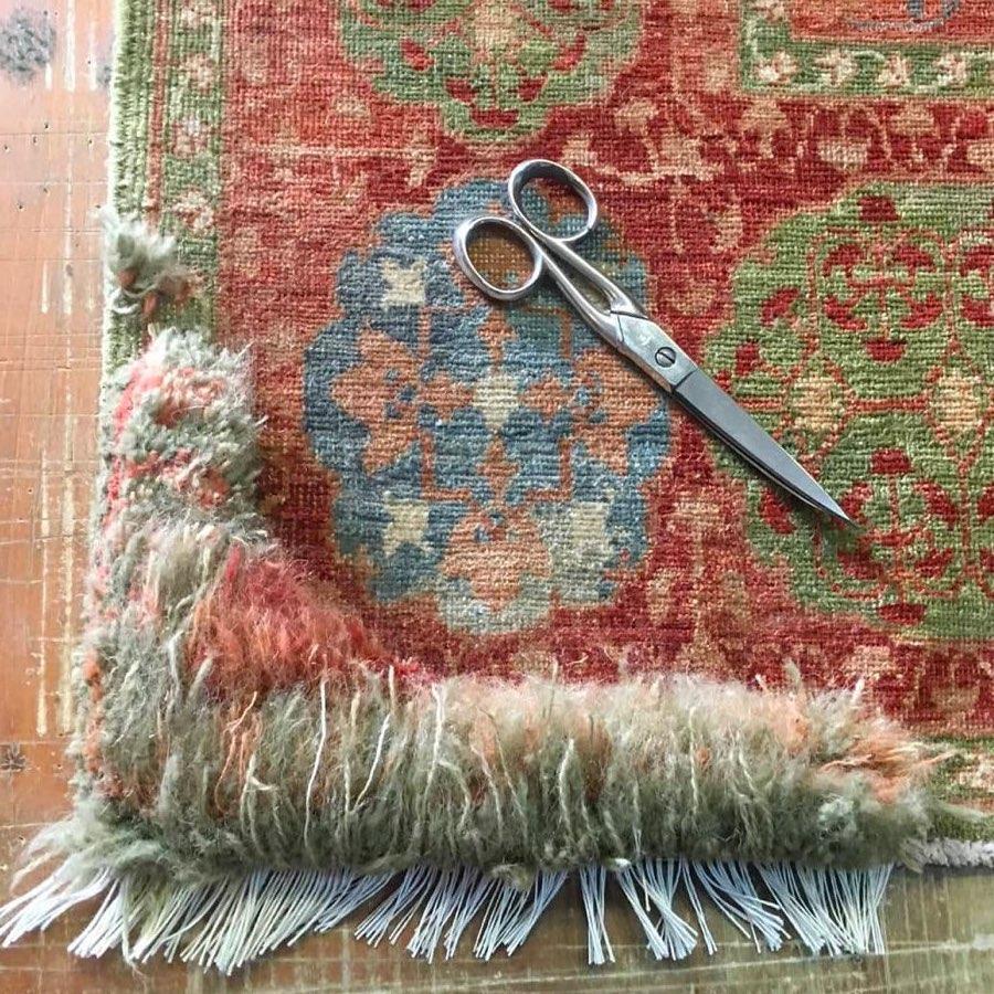 Hand-knotted Mamluk design rug during restoration, scissors on carpet
