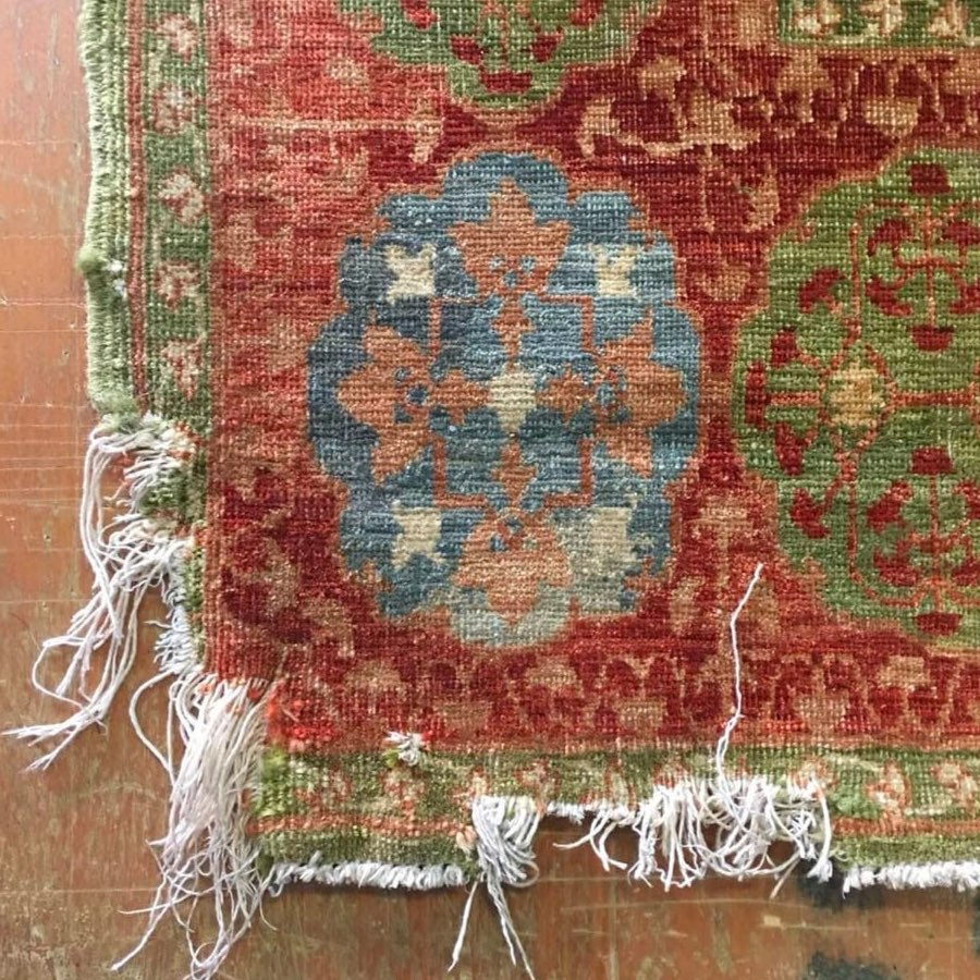 Hand-knotted Mamluk design rug corner chewed by a dog