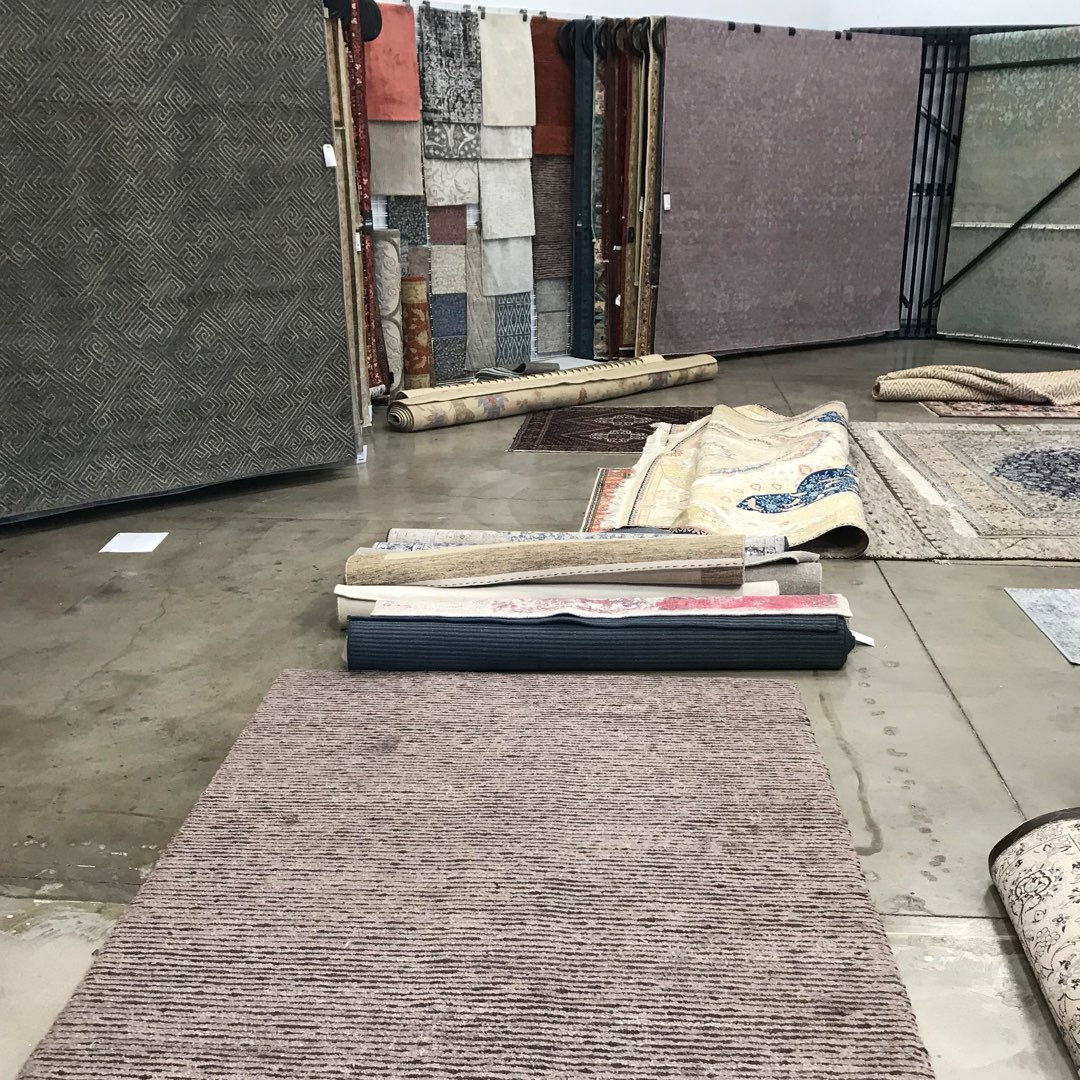 Oriental Rug and Carpet Clinic store front. Rugs on the floor