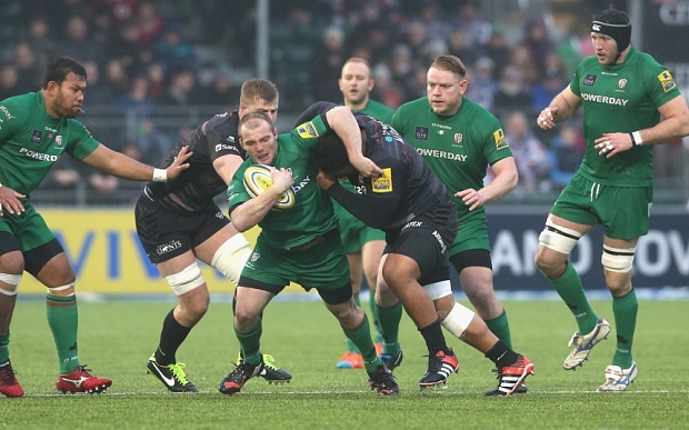 Saracens v London Irish - Aviva Premiership...BARNET, ENGLAND - JANUARY 03:  Harry Allen of London Irish is tackled during the Aviva Premiership match between Saracens and London Irish at Allianz Park on January 3, 2015 in Barnet, England.  (Photo by David Rogers/Getty Images)