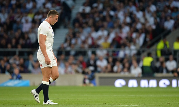 A disappointed Sam Burgess leaves the field following defeat to The Wallabies