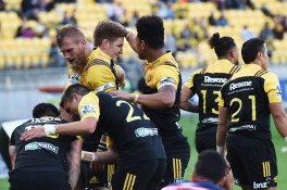 WELLINGTON, NEW ZEALAND - MARCH 04: Nehe Milner-Skudder of the Hurricanes is congratulated by teammates during the round two Super Rugby match between the Hurricanes and the Rebels at Westpac Stadium on March 4, 2017 in Wellington, New Zealand. (Photo by Mark Tantrum/Getty Images)