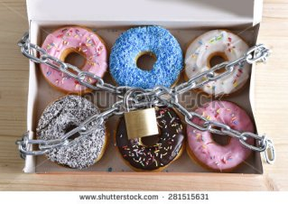stock-photo-box-full-of-tempting-delicious-donuts-wrapped-in-metal-chain-and-lock-in-sugar-and-sweet-addiction-281515631