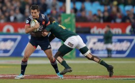 France's Brice Dulin, left, is tackled by South Africa's Raymond Rhule' during the international rugby union test match between South Africa and France at Loftus Versfeld stadium in Pretoria, South Africa, Saturday, June 10, 2017. (AP Photo/Themba Hadebe)
