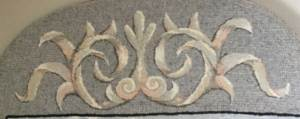 fine cut shaded scroll, rug hooked with multiple swatches