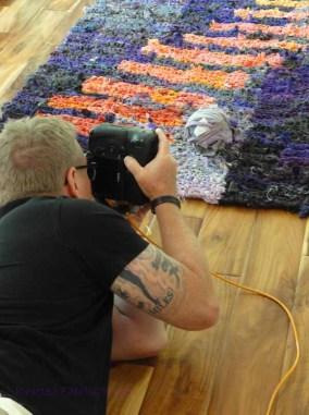 Kip Dawkins shooting a ball of tie-up on its rug.