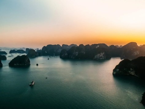 Sunrise over Halong Bay, Vietnam. Beautiful colors over the limestone cliffs.
