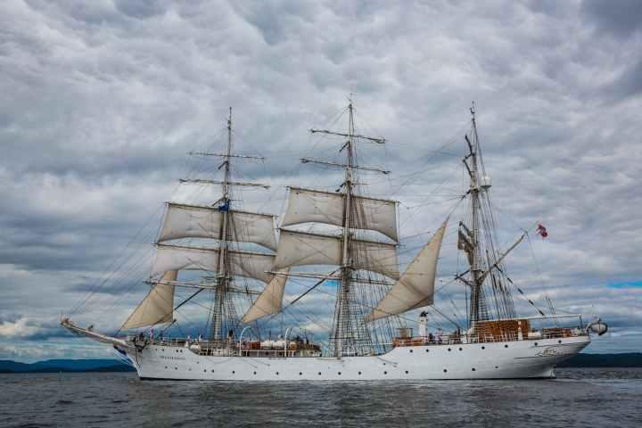 boat classic clouds cruise